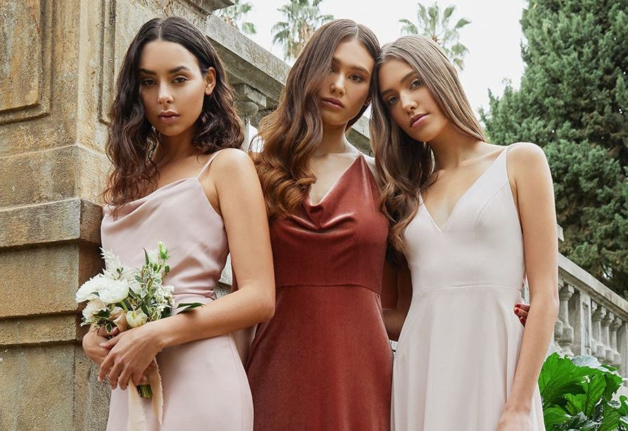 Bridesmaids wearing bordeaux evening dresses
